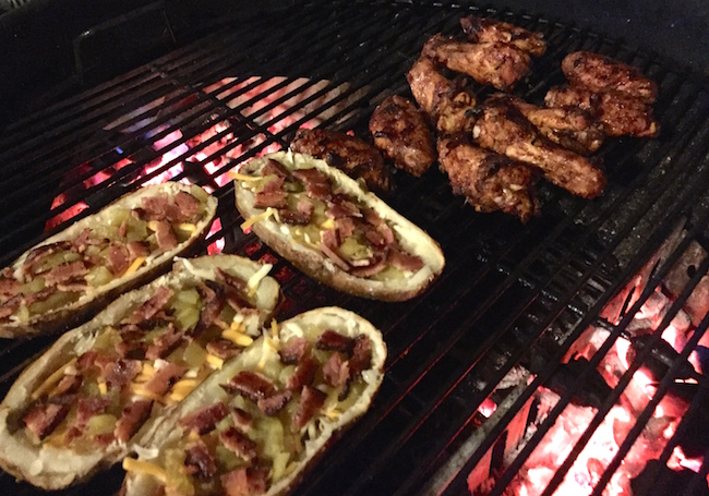 grilled potato skins on a weber kettle grill