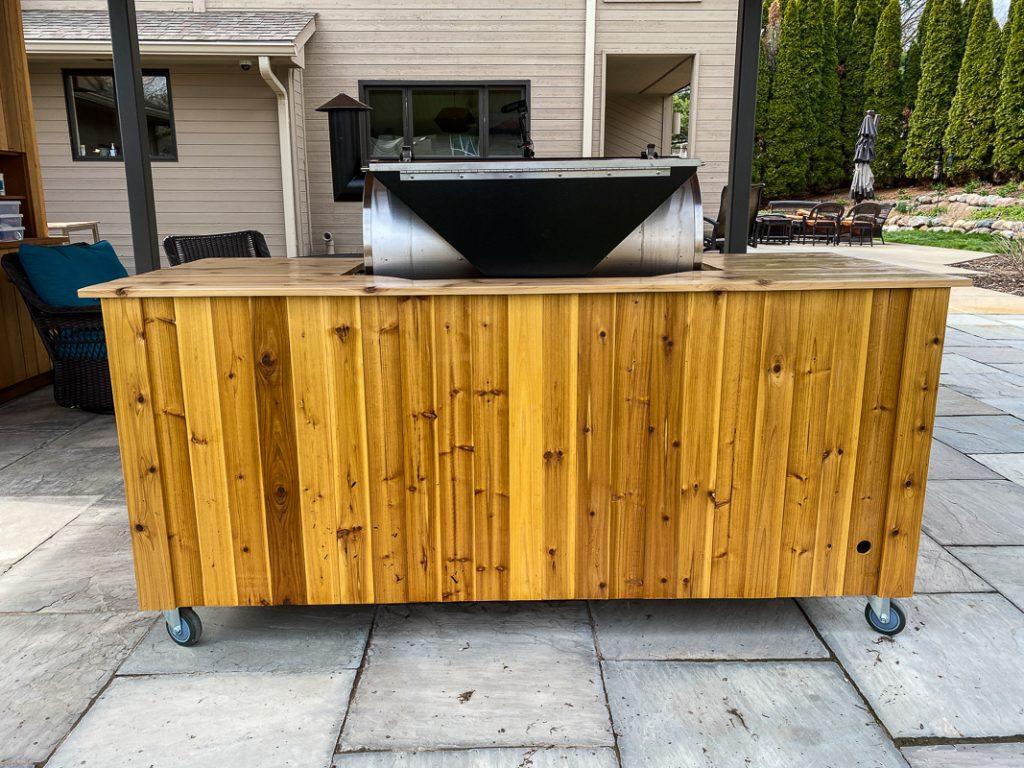 bask side of a cedar rec tec grilling cart